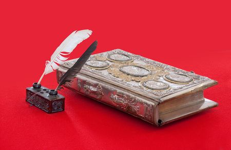 15st century vintage book and standish on red  photo