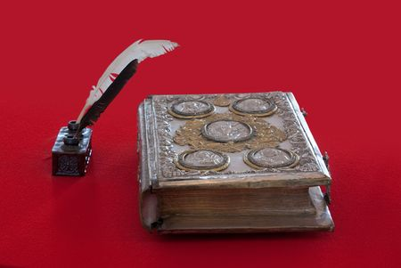 matters: 15st century vintage book and standish on red Stock Photo