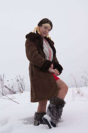 young woman in sheepskin and fur high shoes Stock Photo