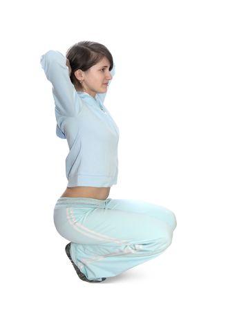 teener: girl in light activewear is doing fitness exercises  Stock Photo
