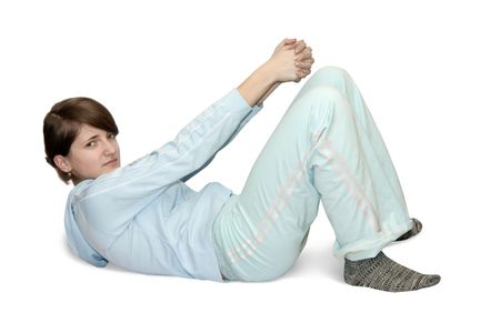 girl in light activewear is doing fitness exercises  Stockfoto