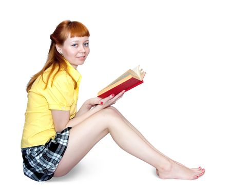 Reading girl in short skirt. Isolated on white Stock Photo