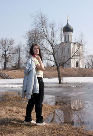 Girl near Church of the Intercession on the River Nerl photo