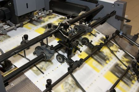 ofset: making yellow newspapers at offset printed machine
