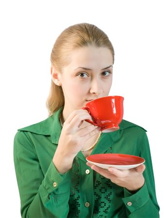 girl in green blouse drinks tea from a red cup photo