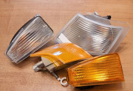 headlamp: new automobile headlamp on wooden table Stock Photo