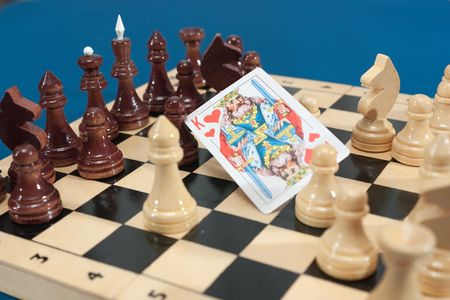 the king of heart on Chess board with chess figures