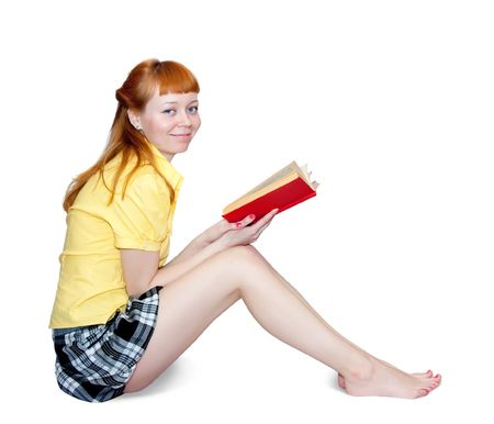 sexy teen: Reading girl in short skirt. Isolated on white Stock Photo