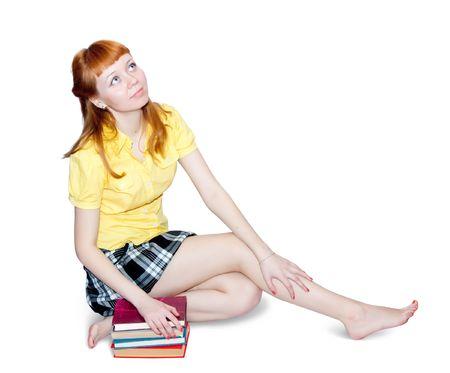 falda corta: sexy chica en falda corta con los libros. Aislado en blanco