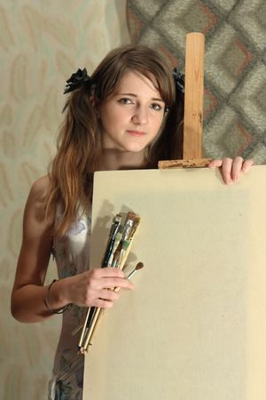 girl with brushes near blank white canvas Stock Photo - 4979782