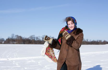 teener: girl in russian traditional clothes  against  Russian landscape