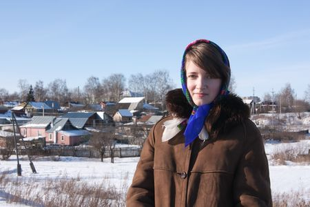 girl in russian traditional clothes  against  Russian landscape