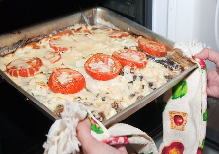 bakeoven: Grilled fresh fish with tomato in oven