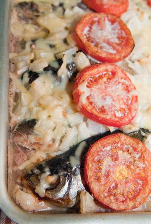 river fish: baked pudding from river fish  in a cook griddle Stock Photo