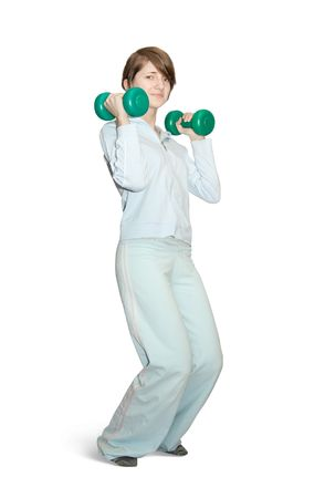 activewear: girl in activewear is doing fitness exercises with barbell Stock Photo