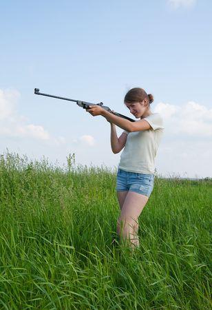 The woman aiming a pneumatic air rifle photo