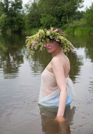 undine: Girl dressed in pareo and flower wreath  in river