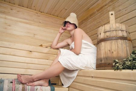 Young woman take a steam bath at sauna Stock Photo - 5202160