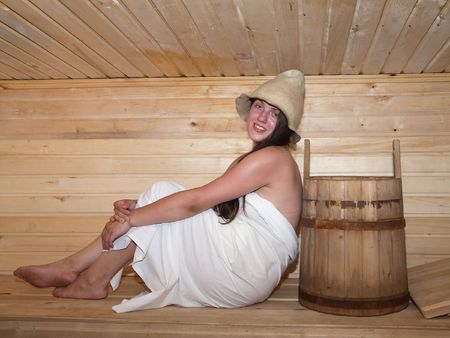 stive: Young woman is sitting at sauna bath