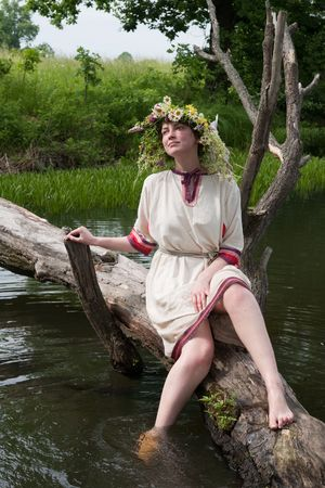 undine: girl  in russian traditional clothes against river