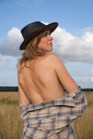 Topless girl in cowboy hat against sky Stock Photo - 5334490