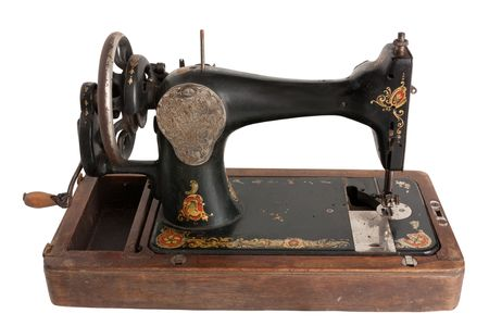 Vintage Sewing machine isolated over a white background photo