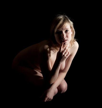 blond naked girl. Isolated on black background Stock Photo - 5364789
