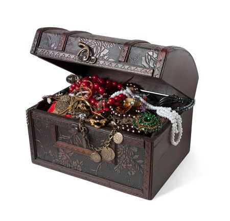 Wooden treasure chest with bijouterie, isolated photo