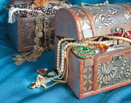 Two wooden treasure chests with valuables on blue textile Stock Photo - 5379577