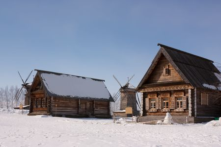wooden village  household in frosty winter day photo
