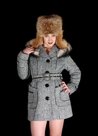seasonable: young woman in gray coat and hat with earflaps