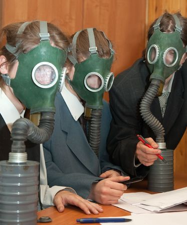 The girls in a gas mask at nterior Stock Photo - 5464072