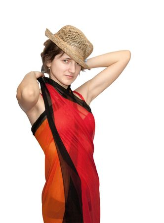 brunette girl in straw hat dresses a pareo. Isolated over white. photo