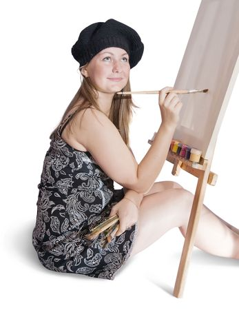 Girl with brushes near blank white canvas. Isolated over white Stock Photo - 5482866