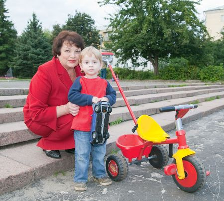 Happy grandmother with her grandchild  outdoors photo