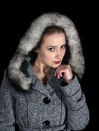 woman in gray coat on black background photo