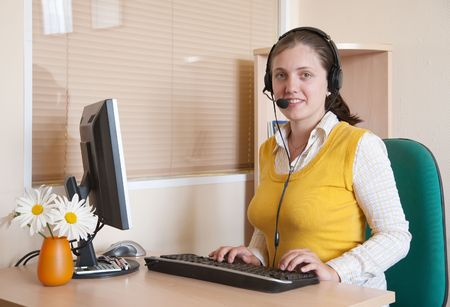 Beautiful charming  businesswoman communicating on headset and smiling  photo