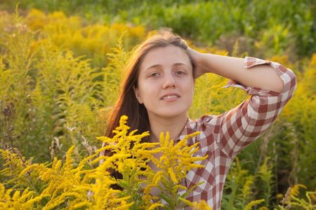 teener: beauty long-haired girl in grass during sunset Stock Photo
