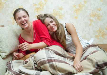 Two young girls happy girls at home photo