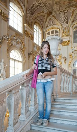 Female tourist in Interiors of Winter Palace at St. Petersburg, Russia photo