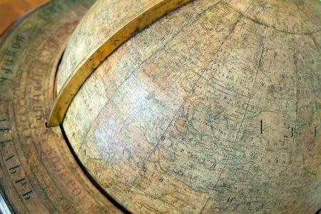 Background of closeup of vintage globe photo