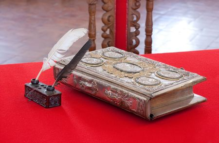 15st century vintage book and standish on red table Stock Photo - 5571910