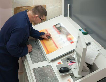 polygraph: Printer checking a print run at table Stock Photo