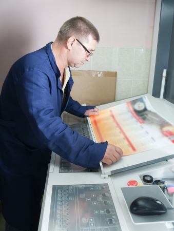 printer paper: Printer at the electronic control panel of offset machine