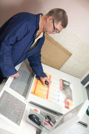 Printer at the electronic control panel of offset machine Stock Photo - 5593141