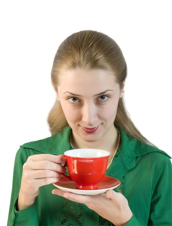 girl drinks tea from a red cup photo