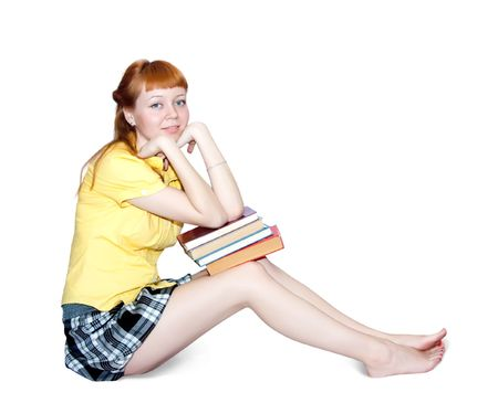 carroty: carroty girl in short skirt with books. Isolated on white
