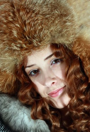 furskin: long haired young woman in fox hat