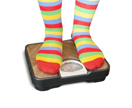 Woman weighing herself on a bathroom scale  photo