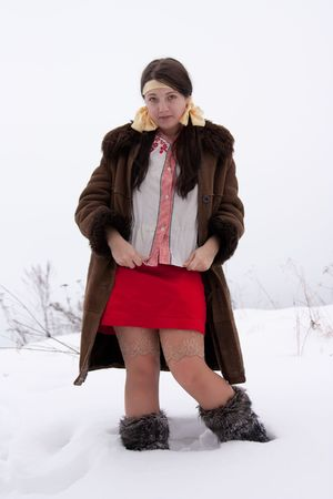 obscure: young woman in sheepskin and fur high shoes Stock Photo